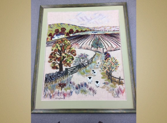 Embroidery  re-framed after poor framing undertaken previously